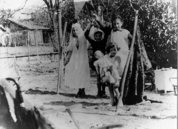 Miryam in fancy dress, playing with other children, around 1939.